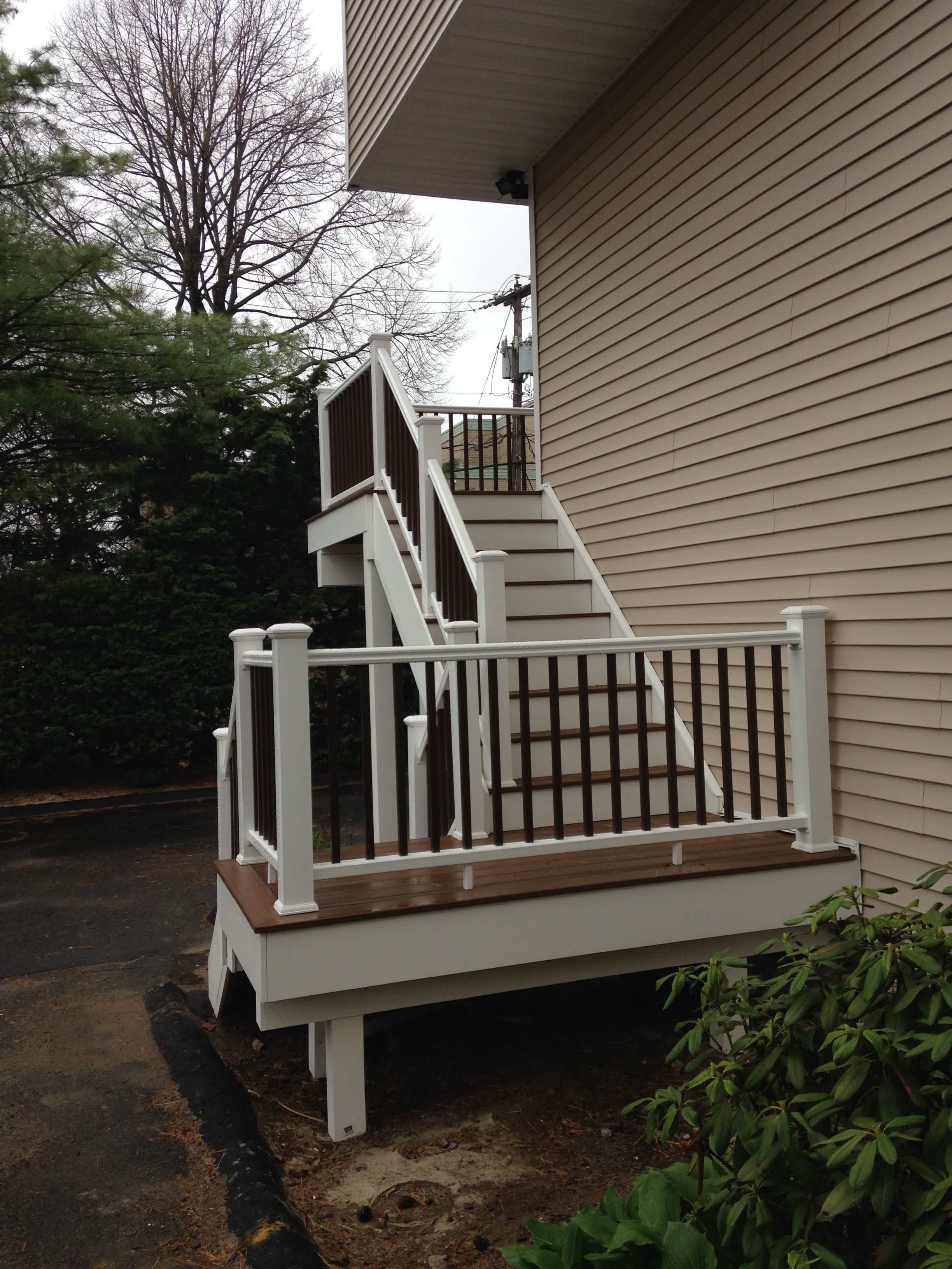 stairs, landing, railings & second story deck replaced for corner