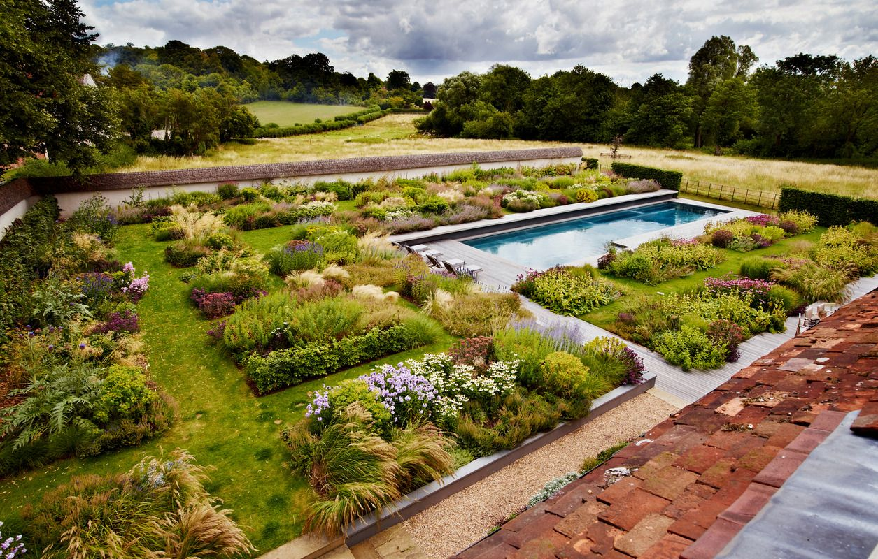 The garden planting is formed into a series of long, bar-shaped beds ...