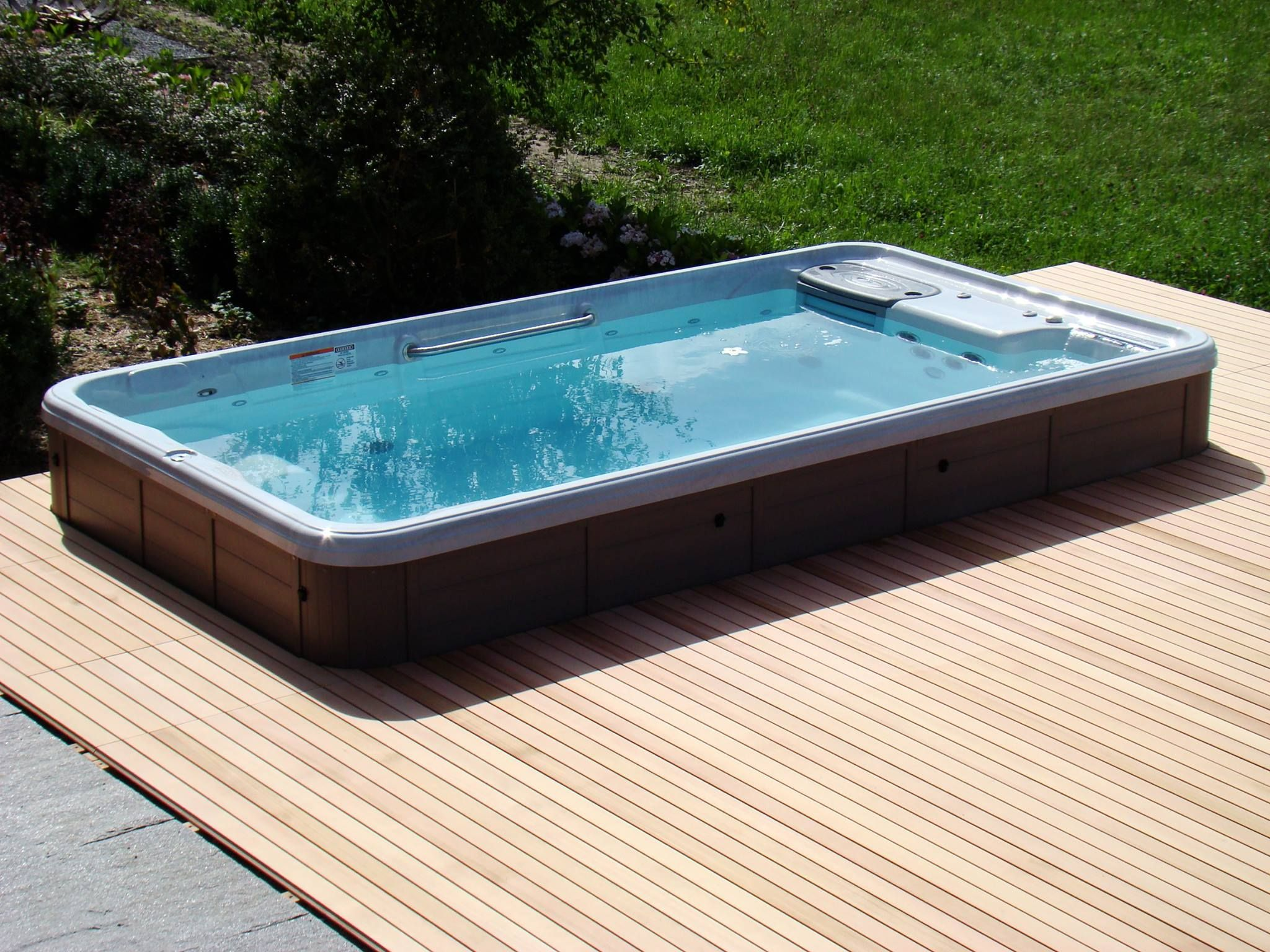 Semi inground tidalfit swim spa exercise pool outdoor for Outdoor jacuzzi designs and layouts