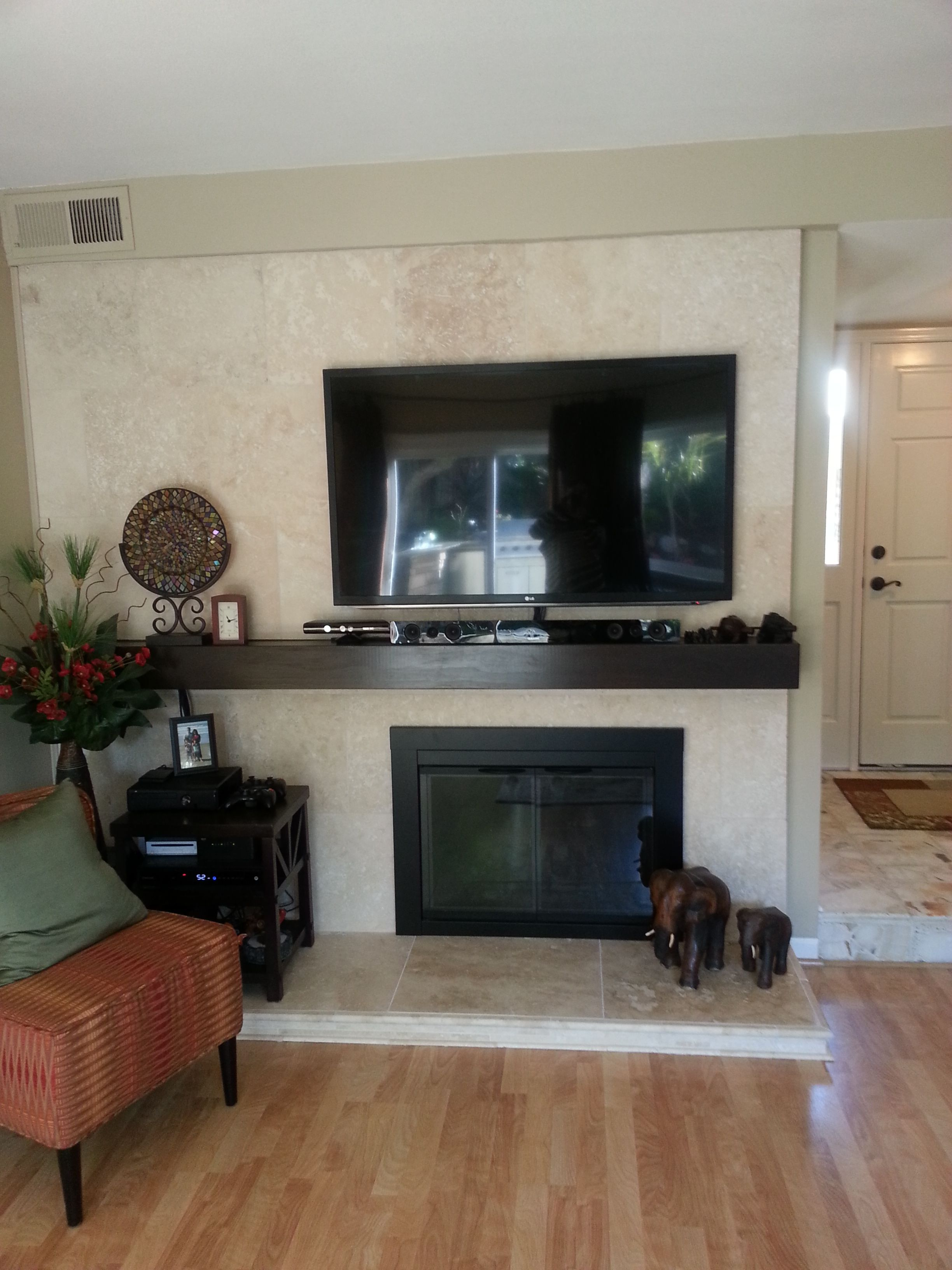 limestone or travertine tile as fireplace surround. used 18 x 18