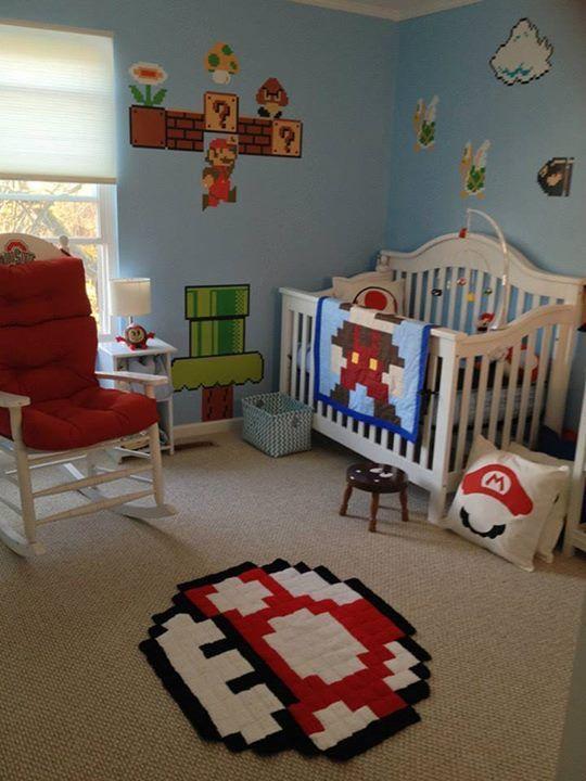 Super Mario Bros themed baby nursery - Mario blanket, mushroom rug, goomba stool, Mario mobile, and more.