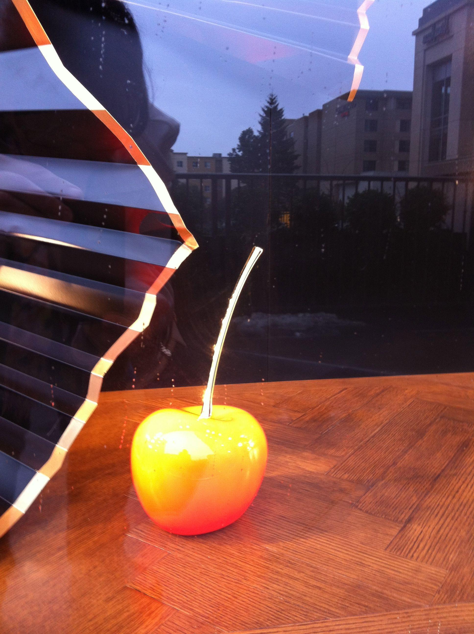 Glass Cherry in L. Vuitton window. Bellevue WA