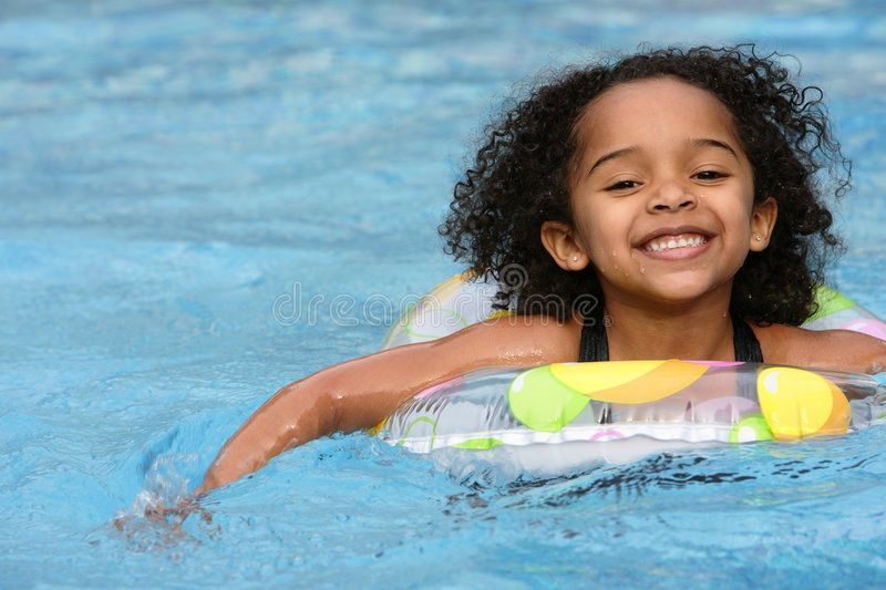 Afro Child Swimming. Cute little girl in a swimming pool , Afro Child Swimming. Cute little girl i