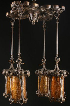 AN ART NOUVEAU BRONZE AND AMBER GLASS CHANDELIER : Lot 715