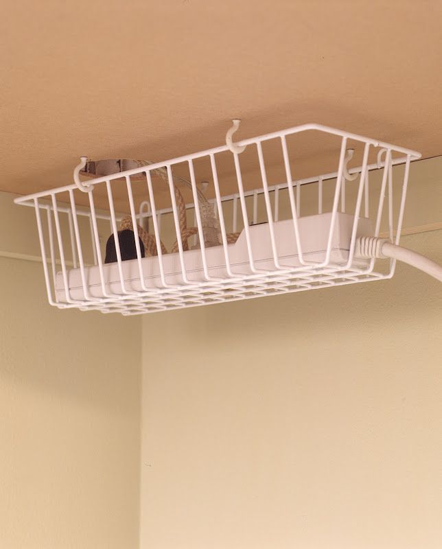Use screw hooks to hang a basket under your desk to keep cords