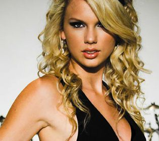 Taylor Swift in a black halter dress, peach lipstick and loose curls...stunning!