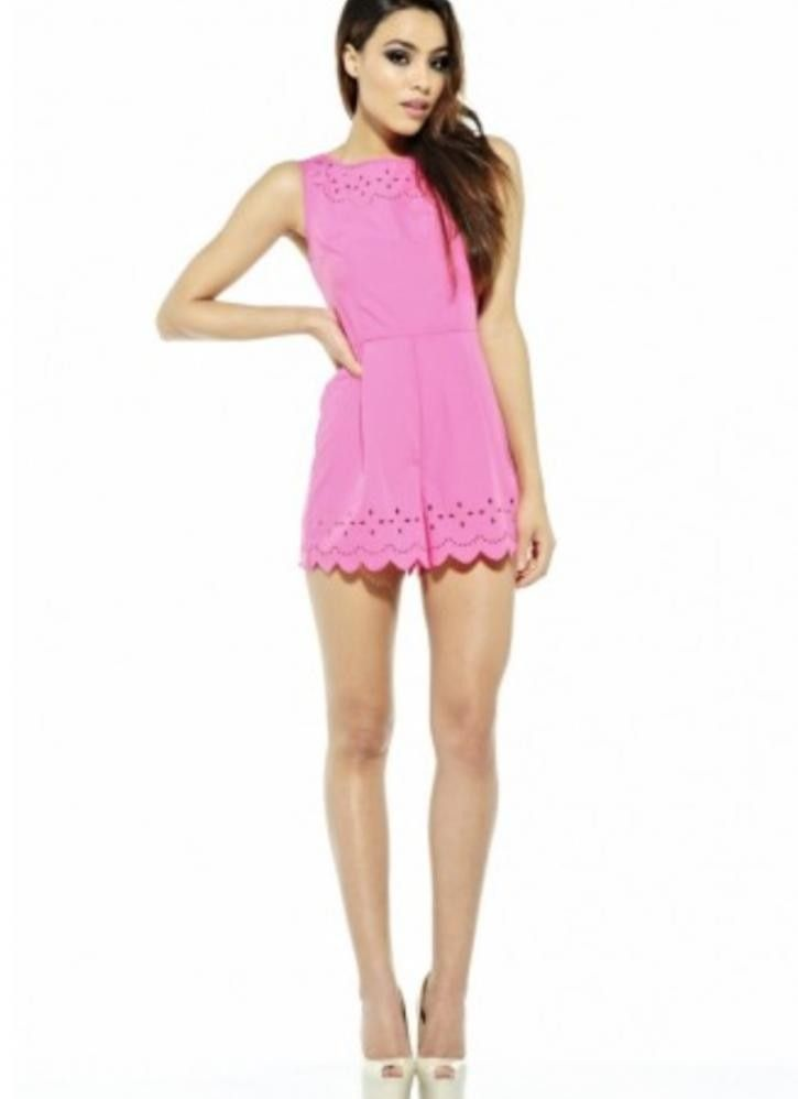 c29856ffe10 This gorgeous plain style romper with added laser cut out around the neck  and hem detail is perfect for your summer holidays and festivals and will  see you ...