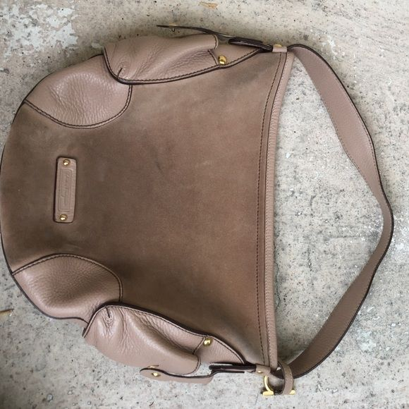 Ferragamo Suede Bag Bag is in good shape but not great shape. Suede just needs a cleaning, has one tiny ink line on side pocket, one by strap and a couple inside. I believe it to be authentic but don't know for sure. Priced to sell, please look at pictures Ferragamo Bags