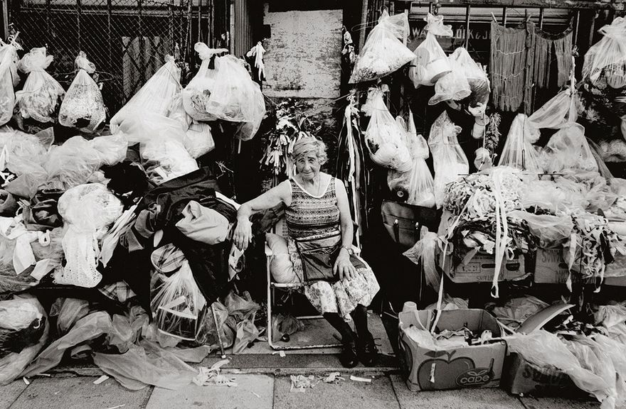 Bags with small items for sale at Hackney Market, London 1979..Photo by Jürgen Schadeberg.   | T