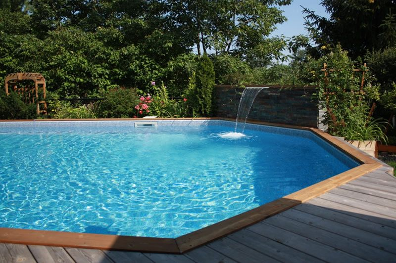 Onground pool with waterfall dream pools pinterest for Above ground pool waterfall ideas