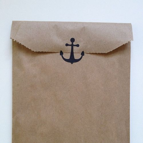Simple anchor stamps on brown paper bags
