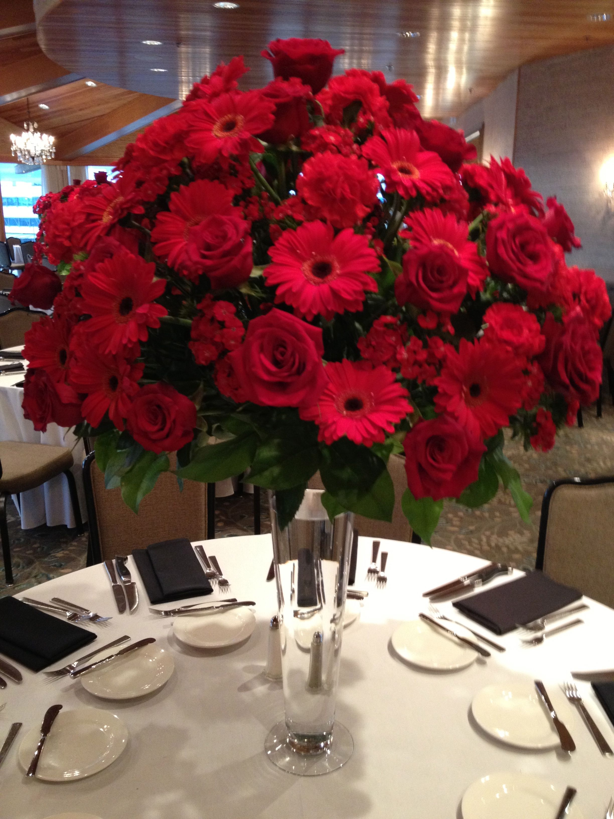 Centerpiece 22 inch pilsner vase topped with arrangement of red centerpiece 22 inch pilsner vase topped with arrangement of red roses red gerbera daisies reviewsmspy