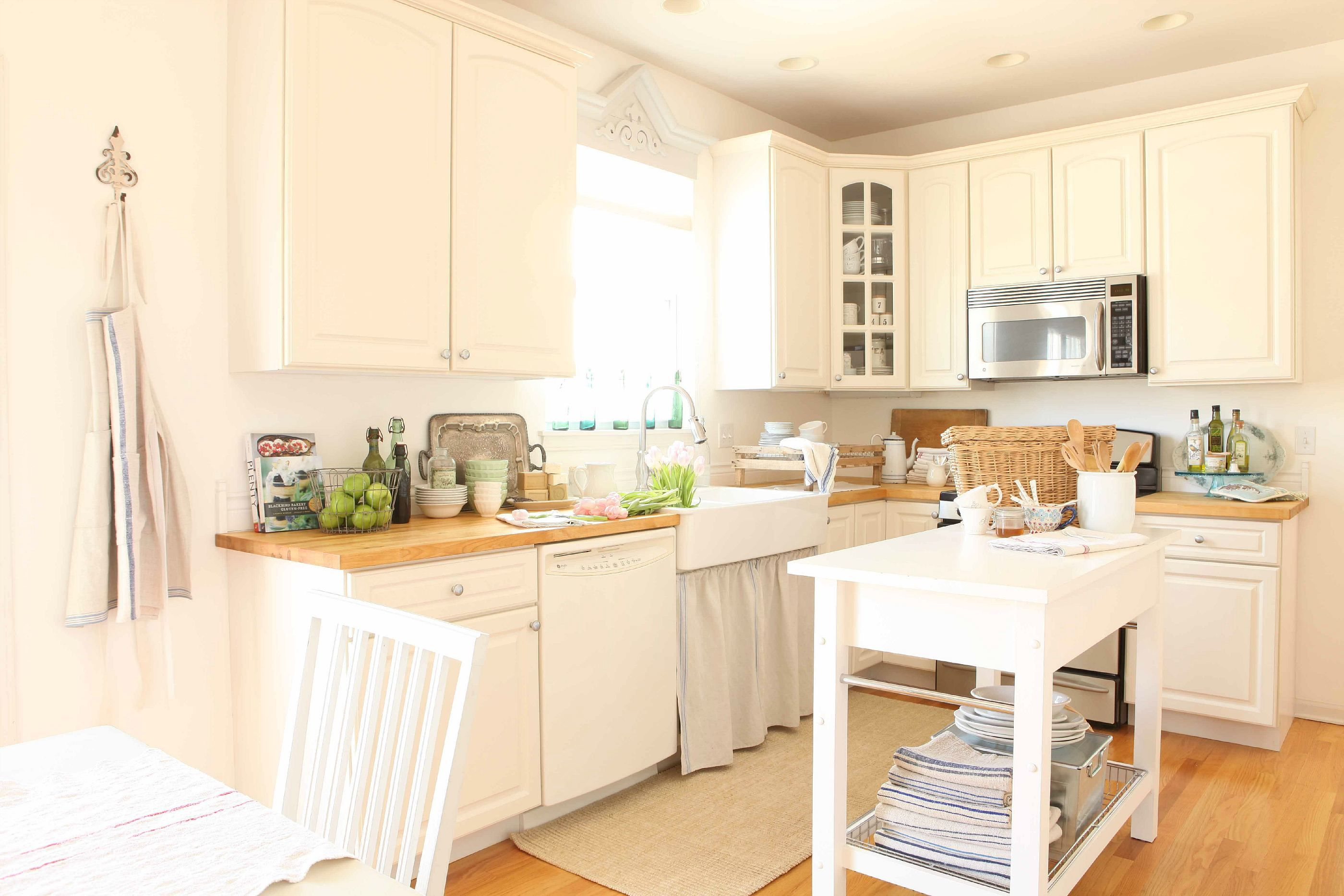 My kitchen...wood countertops and farmhouse sink from Ikea