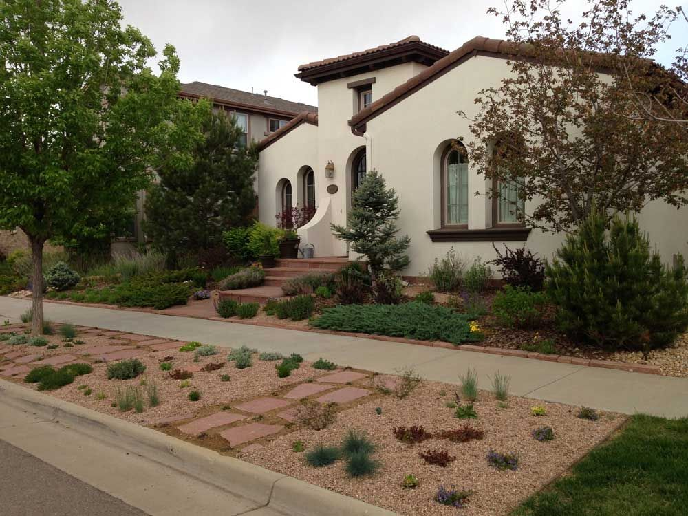 Hardscape Materials Plantings Were Chosen To Complement The Architecture Of This Spanish Style Home Designed By Sara Hardscape Landscape Spanish Style Home