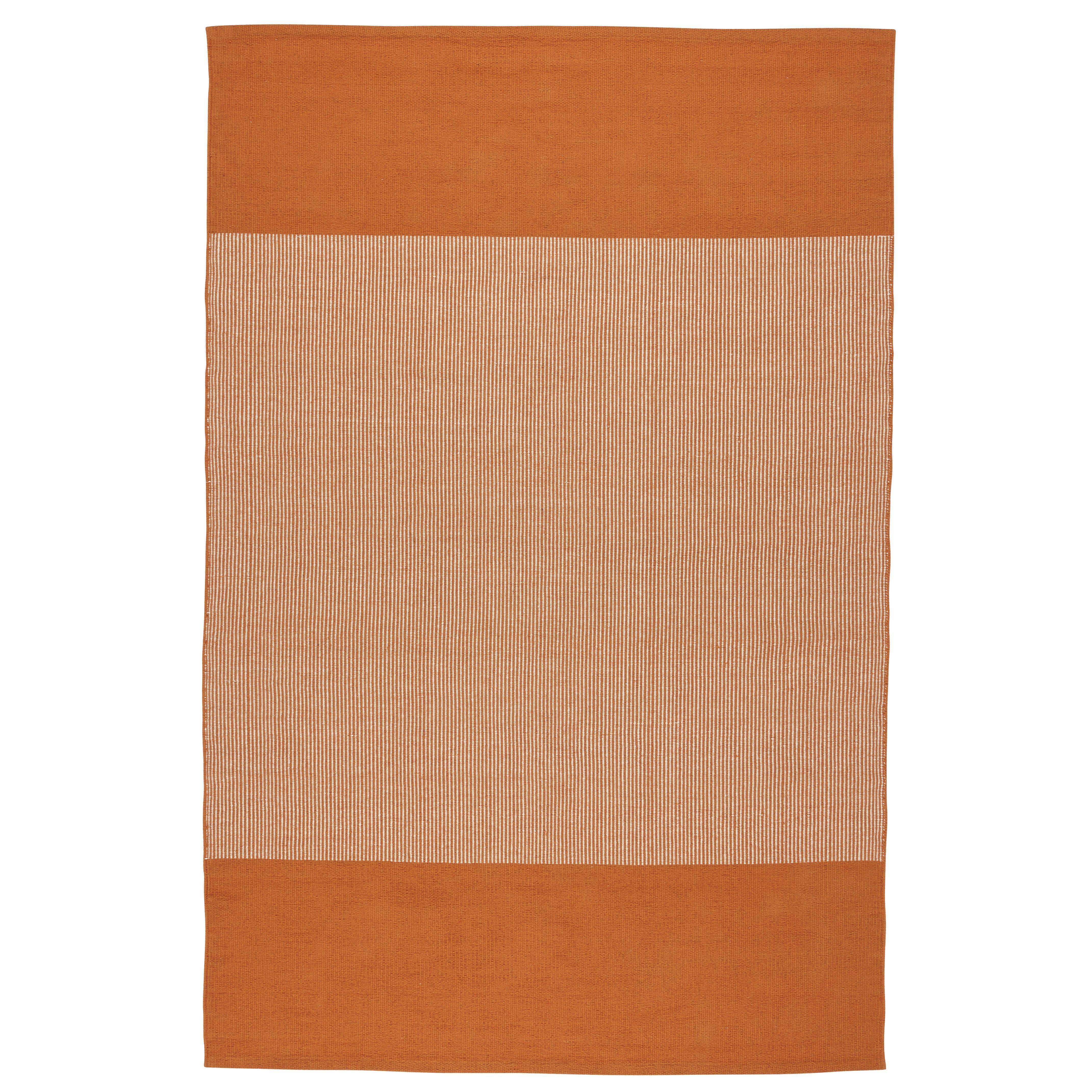 Sidebar orange rug launching in January 2015 brings in a pop of orange.