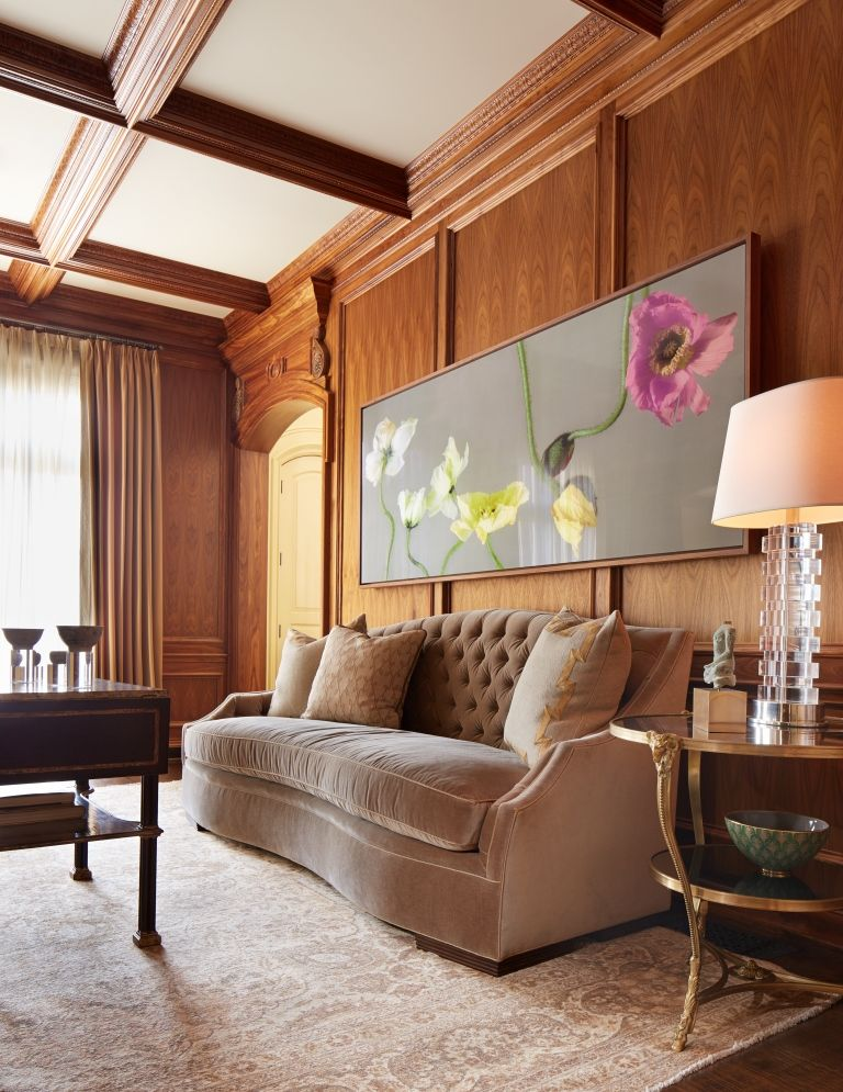 Inviting Living Room With Wood Paneling Wall & Warm Color ...