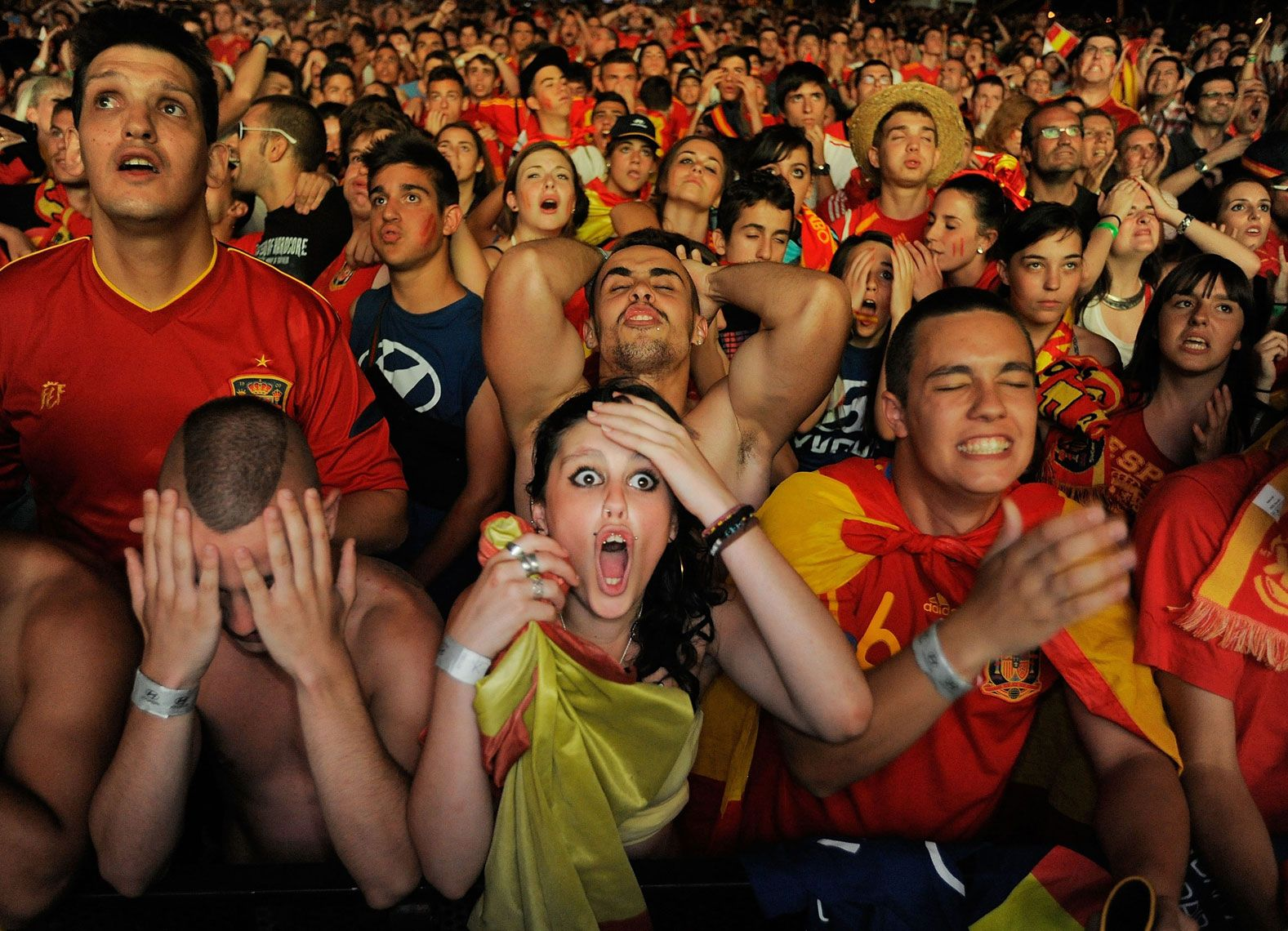 Spanish football fans watching a game