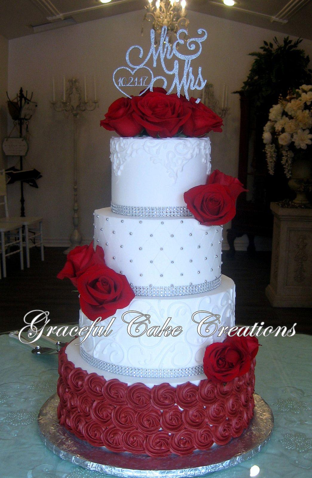 Elegant White Butter Cream Wedding Cake With Burgundy Rosettes