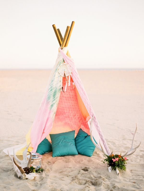 Dip-dyed pastel teepee on the beach | Photo by Justine Milton