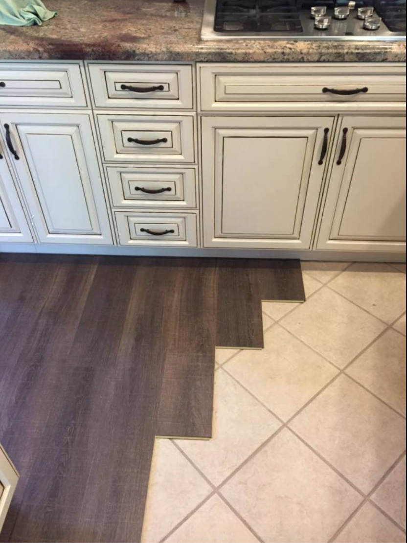 Margate oak coretec floors installed over tile cork for Kitchen flooring installation