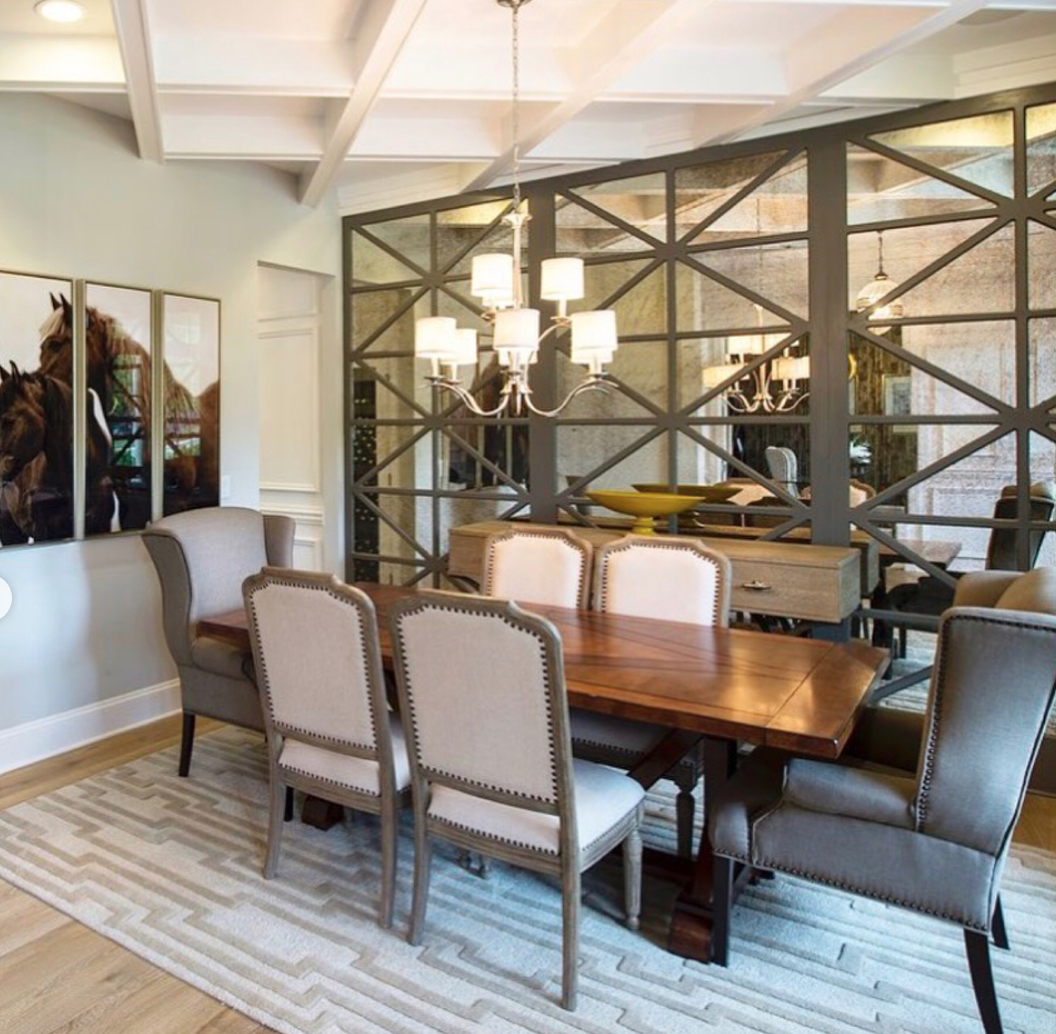 Reflections and neutral angles abound in this dining room ...