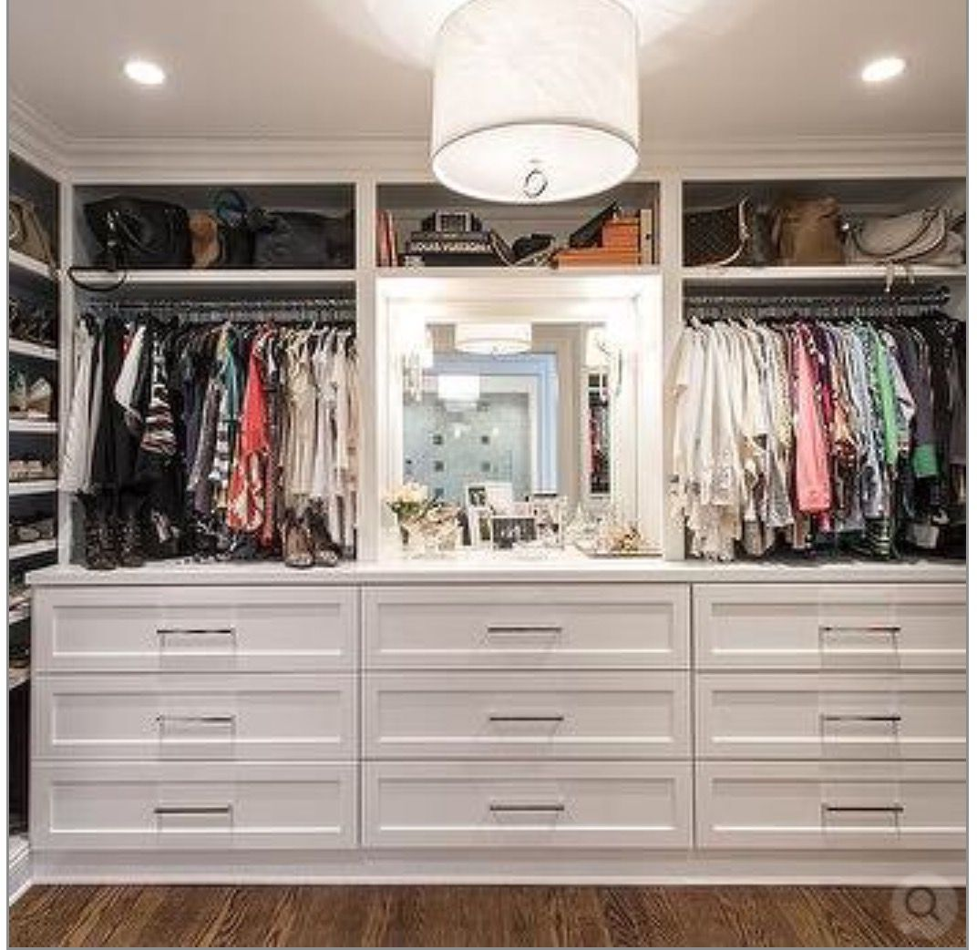 Chic Walk In Closet Features Floor To Ceiling Built Shelves Filled With Designer Bags And Shoes