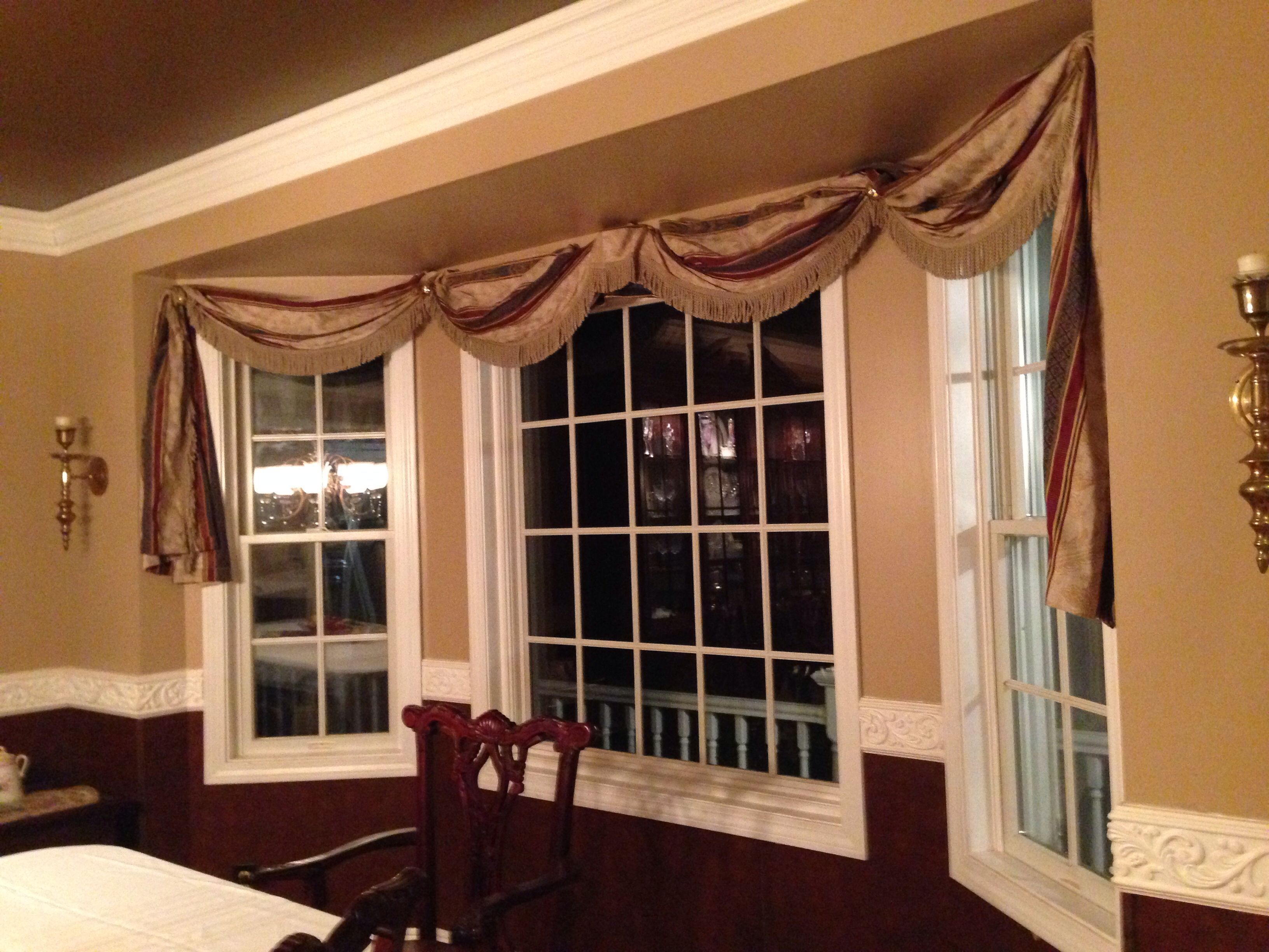 Window coverings arched windows  dining room with paneling and molding curtains u windows  home