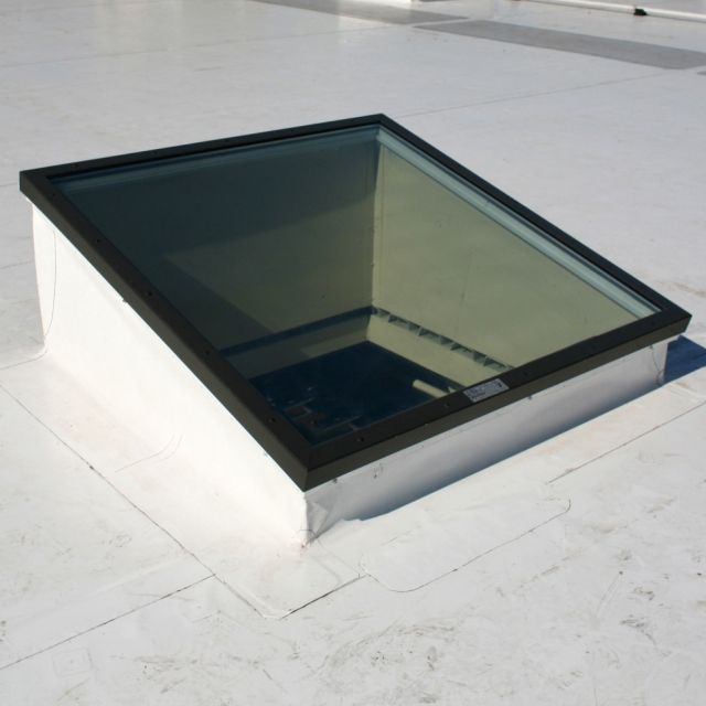 Skylights For Garage: For Flat Or Very Low Slope Roofs, Skylights Are Mounted On