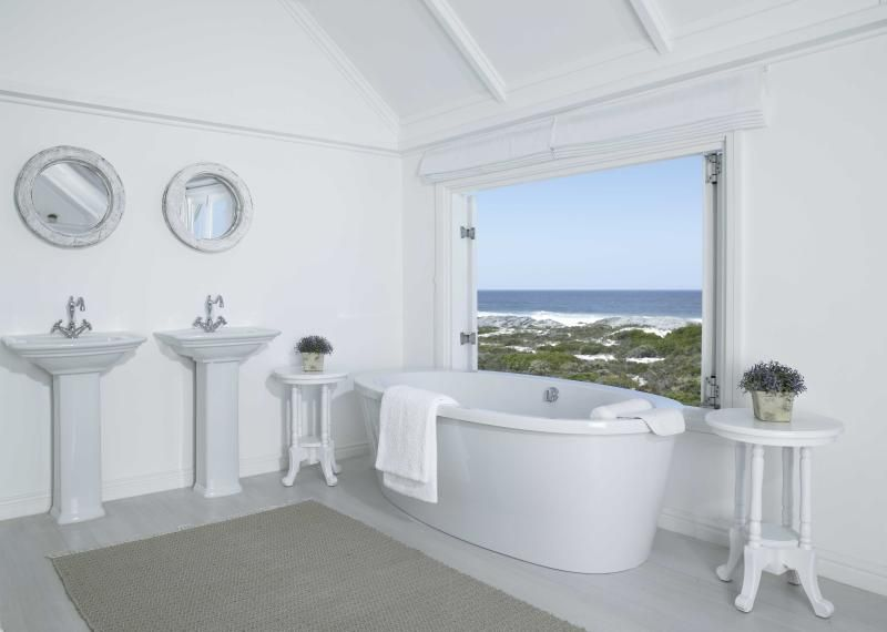 Free standing bath with views across the ocean to Table Mountain. Walk out onto your private balcony