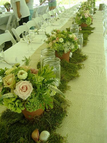 burlap runner, mason jars & touches of moss & pale flowers make a breathe taking table centerpiece