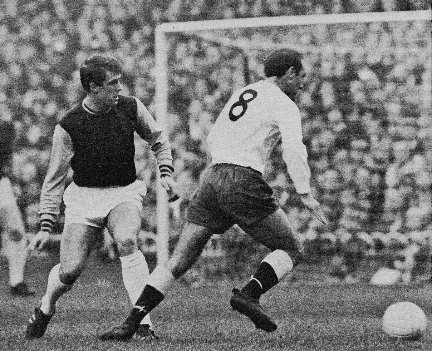 7646840db8e Tottenham Hotspur inside forward Jimmy Greaves running off West Ham United  striker