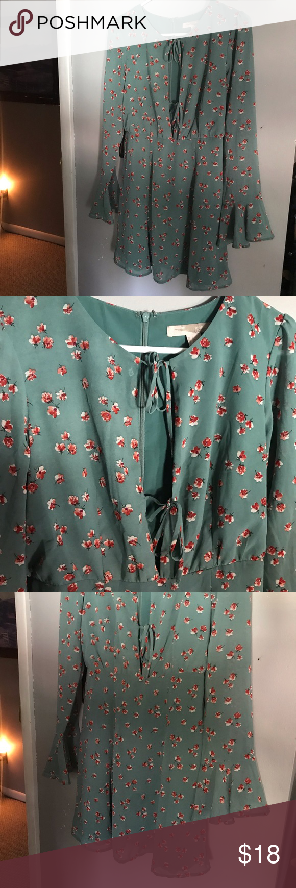Sage green FOREVER 21 floral dress BNWOT Sage green forever 21 floral dress with two ties at the front with a plunge/open neckline. Zippers down back. Never worn, new with out tags. Forever 21 Dresses #sagegreendress Sage green FOREVER 21 floral dress BNWOT Sage green forever 21 floral dress with two ties at the front with a plunge/open neckline. Zippers down back. Never worn, new with out tags. Forever 21 Dresses #sagegreendress
