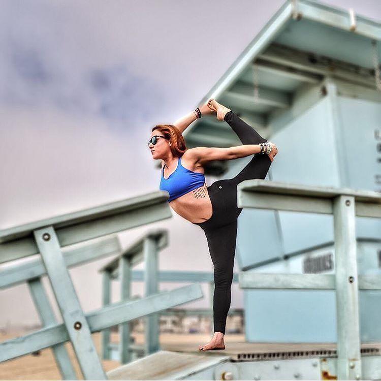 Yoga life @cheryld126 #sunglasses #yoga #beach #lifeguardtower #summer by faroutsunglasses