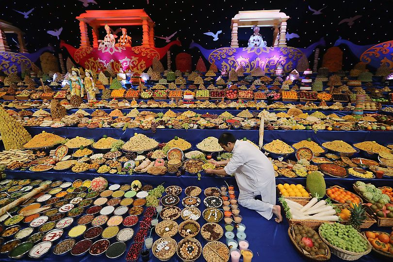Food is placed on the main stage as Sadhus and Hindu men