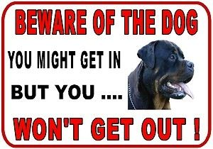 Rottweiler sign- I should hang this outside. Lol.