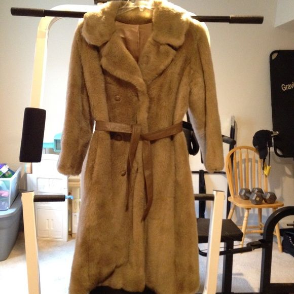 """Full length Royal Minke Coat Appears to be vintage I'm not sure it was in my closet in a garment bag for coats. It has a tie around leather belt and silk lining leather at the button down front . Double breasted with 2 front door pockets . Exceptionally warm. Must clean by furrier method only. Measurements shoulder to shoulder 19"""" , armpit to armpit 21"""" from shoulder to bottom approx 43"""" long . Best I can do wearing it in selfies lol Royal Minke Jackets & Coats"""