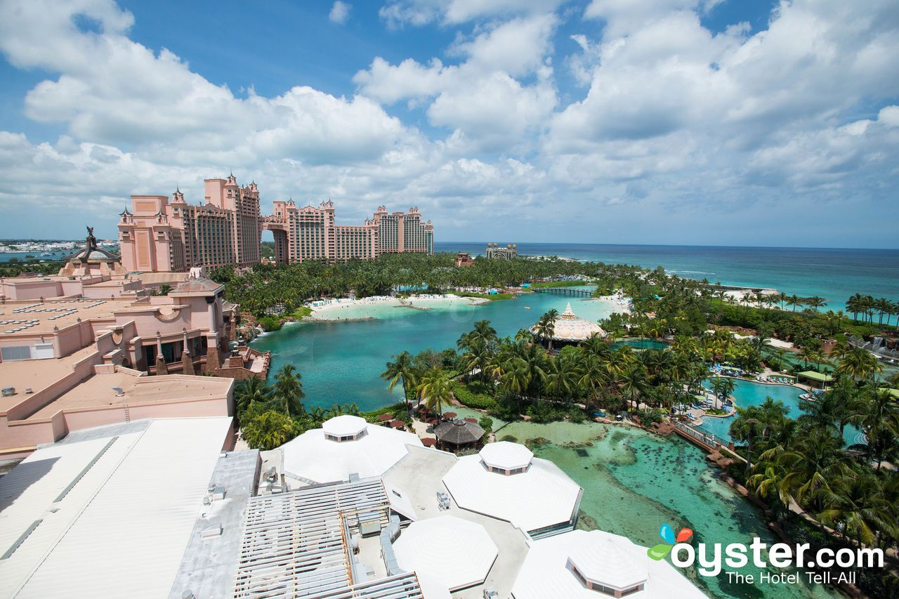 """Anyone arriving to Paradise Island in the Bahamas might think it was manmade specifically for Atlantis. Just over the bridge from Nassau (the country's capital and biggest airport), the island is dominated by the resort's pink structure, Royal Towers, along with its manicured Disney-esque waterscape, lagoons, and marina. Not to mention the name """"Paradise Island,"""" which feels like a handy marketing slogan (for the record, it used to be called Hog Island). Indeed, Atlantis does ru..."""