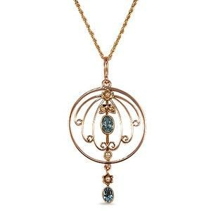 Two mesmerizing oval aquamarine gemstones and five blush toned cultured pearl accents decorate this beautiful circle pendant in yellow gold from the Victorian era (Aquamarine approx. 0.45 total carat weight).