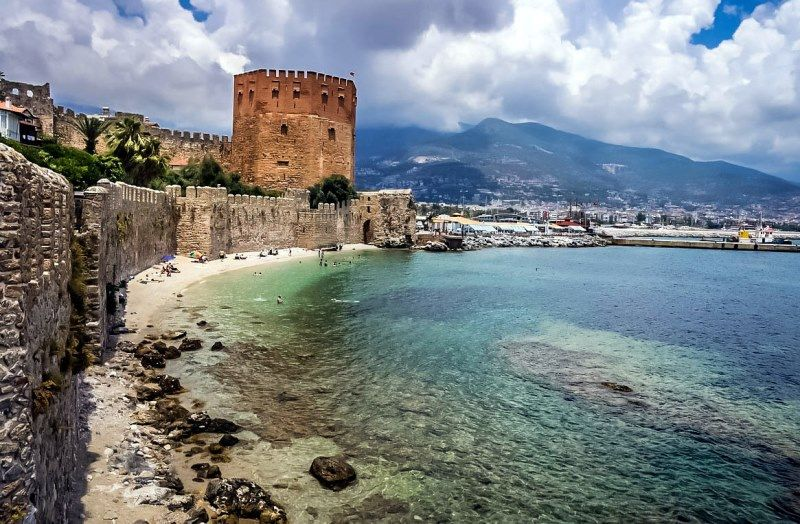 The touristic destination of Alanya in Turkey is the furthest resort from Antalya airport with a transfer time of approximately 2 hours 30 minutes. The 13th-century, 115-metre red tower dominates the coastline, scattered with sandy beaches, although a favourite tourist attraction is Damlatas Cave, with its impressive collections of stalactites. Cleopatra's beach in Alanya is said to be where Cleopatra and Marc Anthony spent time together.