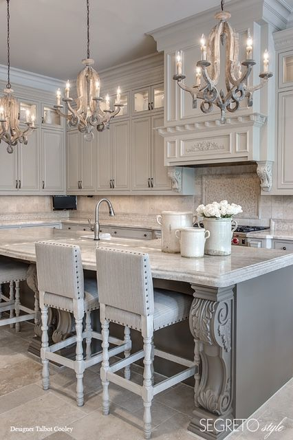 Segreto Secrets - Design Chic Love a gray kitchen and the island with three chandeliers is amazing!