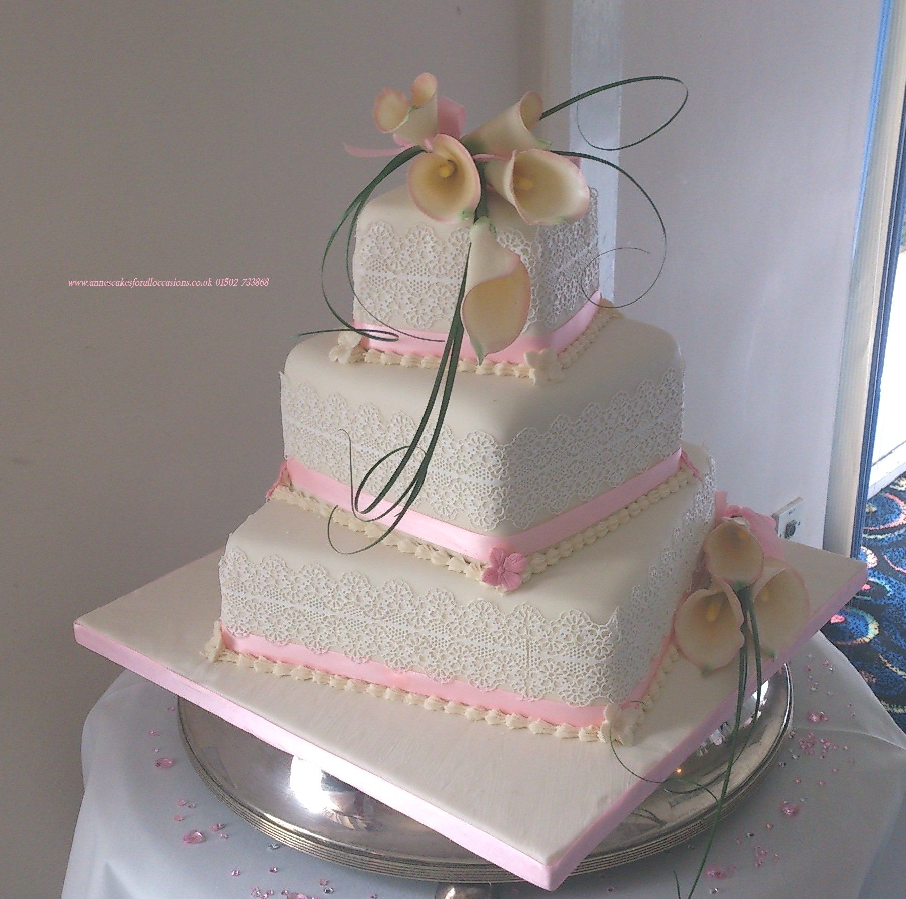 Edible Cake Lace On And 3 Tier Stacked Wedding Adorned With Calla Lily Wired Sugar