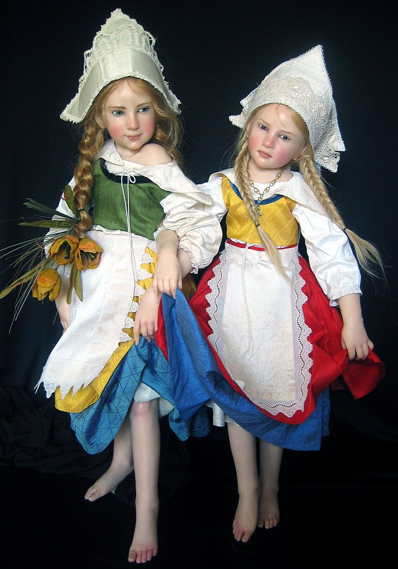 Dutch Girls, by Jamie Williamson, Cernit, human hair, German glass eyes, clothing made form silks hand-dyed to give a worn feel, some antique trims. The girls stand 29 and 32 inches.