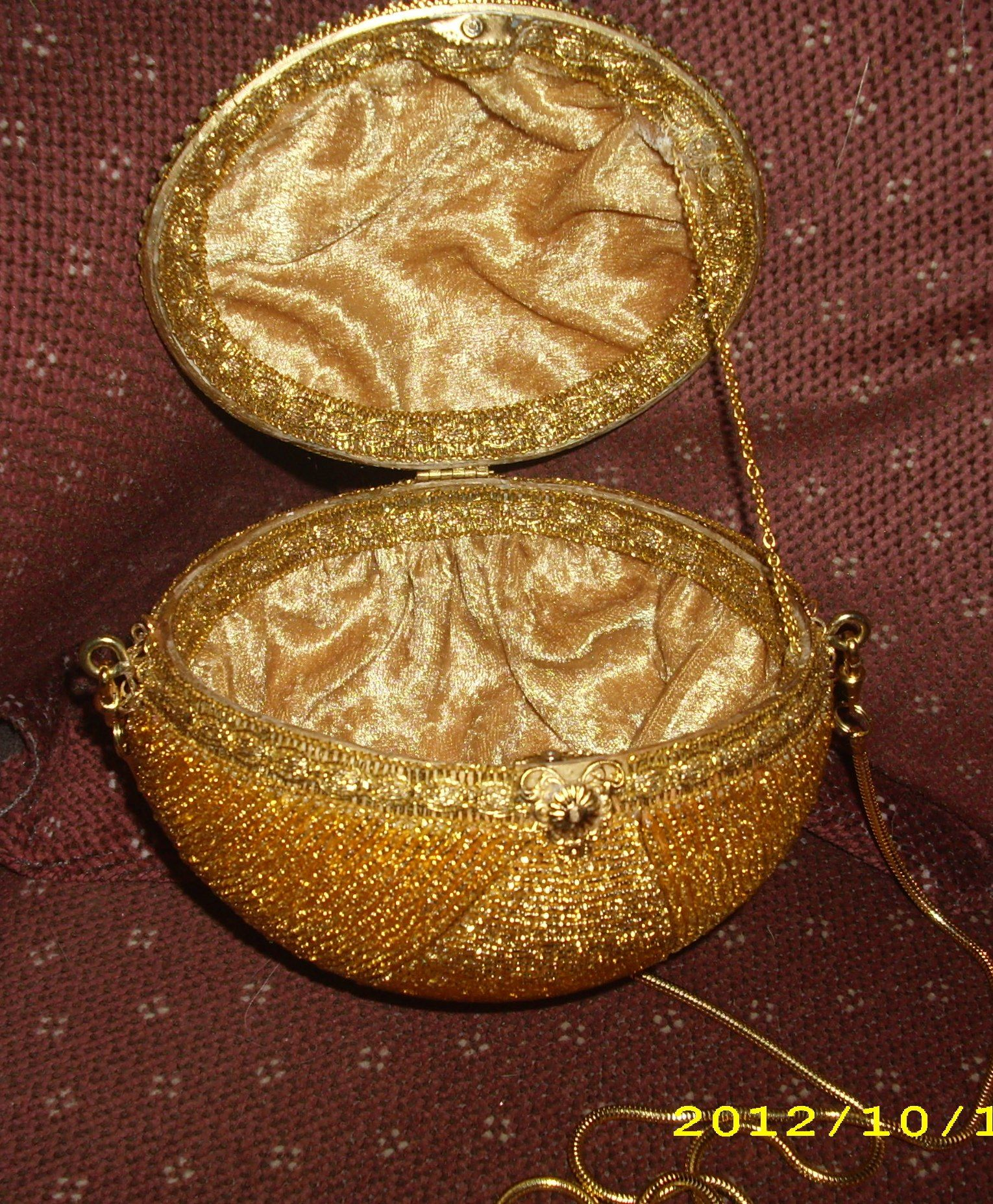 inside of ostrich egg purse gold.