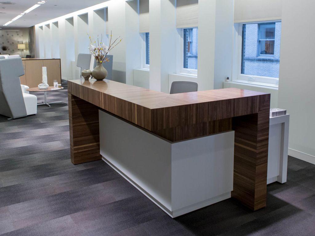 Custom Reception Desk With Flexxy Swivel By Ofs Ofs Neocon Reception Walnut Flexxy Workspace Office Custom Reception Desk Reception Desk Office Design