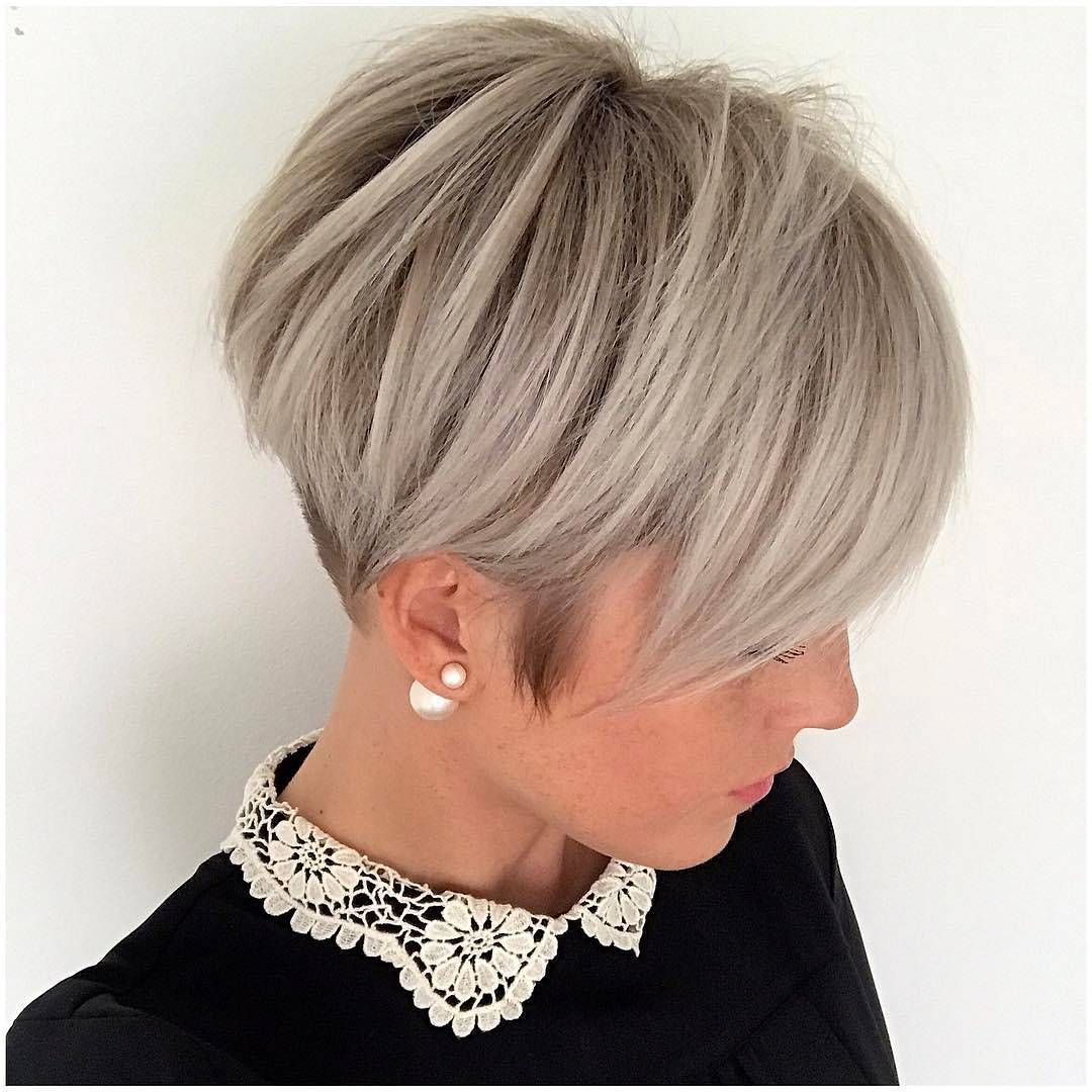 long straight gray two-tone pixie cut with elegant undercut