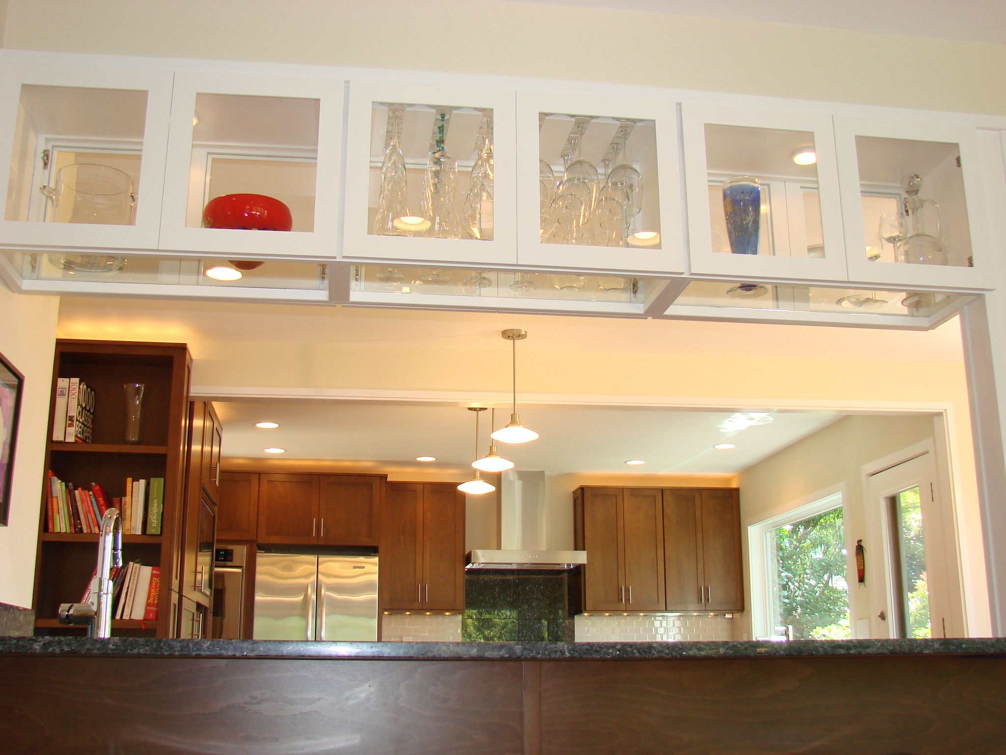 Glass upper cabinet over the island Kitchen Dreams