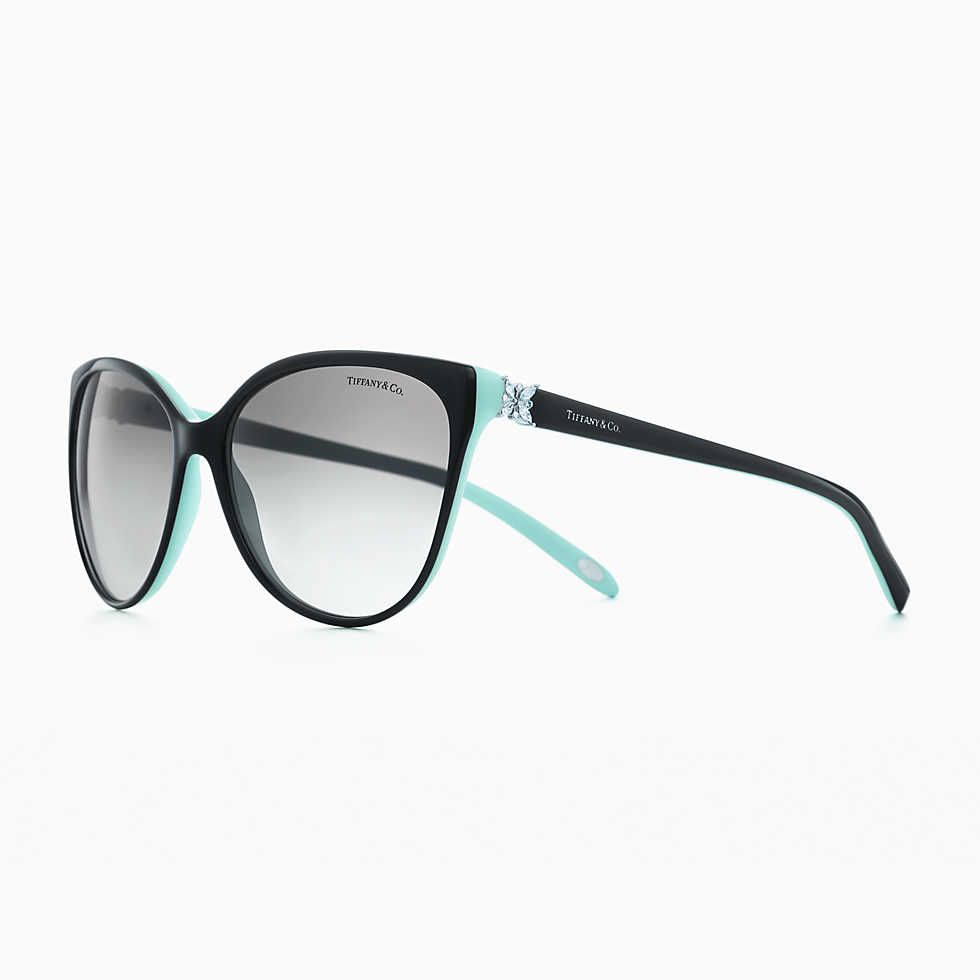 c5b1361a7203f Tiffany T cat eye sunglasses in black acetate and pale gold-colored metal.