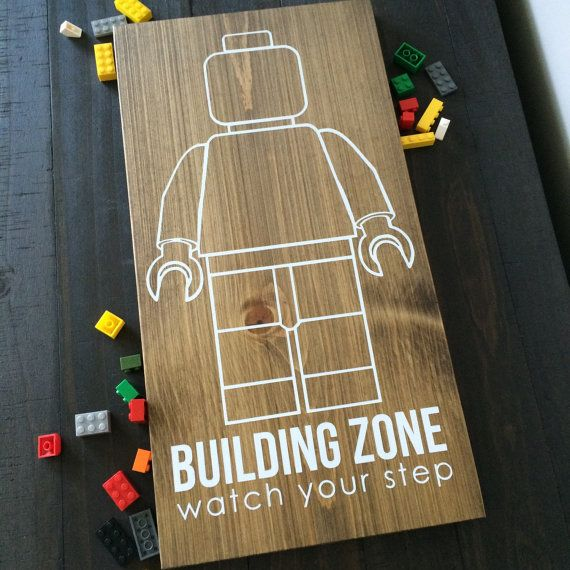 Lego man building zone sign. 9.25x18 approx This listing is for the Lego sign without frame. Comes with sawtooth hanger and felt dots for perfect