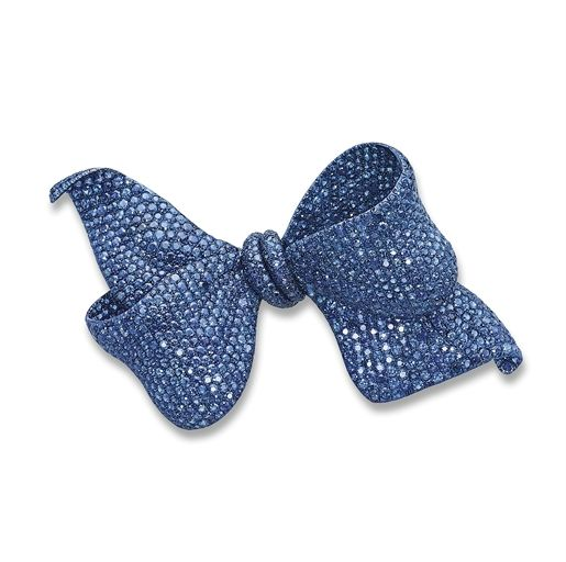 SAPPHIRE BOW BROOCH, BY MICHELE DELLA VALLE Designed as a highly realistic undulating bow, pavé-set throughout with circular-cut sapphires, mounted in titanium, 13.8 cm long, in a fitted Michele della Valle dark blue suede box