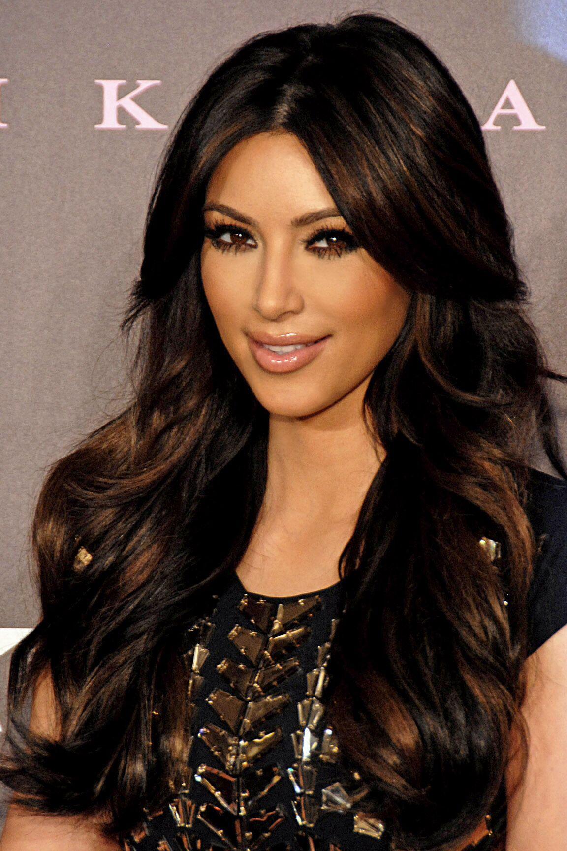 Kim kardashian middle part layered front side bangs on both sides
